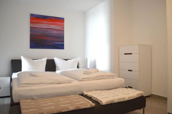 haus-besch-alt-reddevitz-wohnung-auszeit-am-meer-schlafzimmer-mit-doppelbett