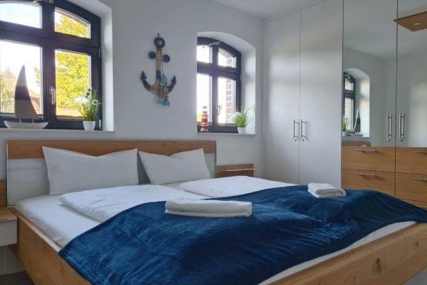 haus-besch-alt-reddevitz-apartment-casa-del-mar-schlafzimmer-2-mit-doppelbett